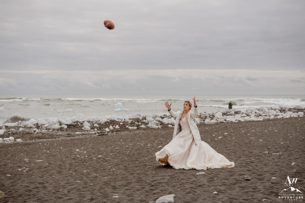Bride catching a football during her Iceland wedding day