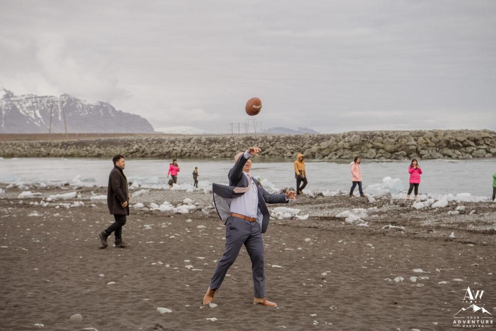 Iceland Groom throwing a football on Diamond Beach