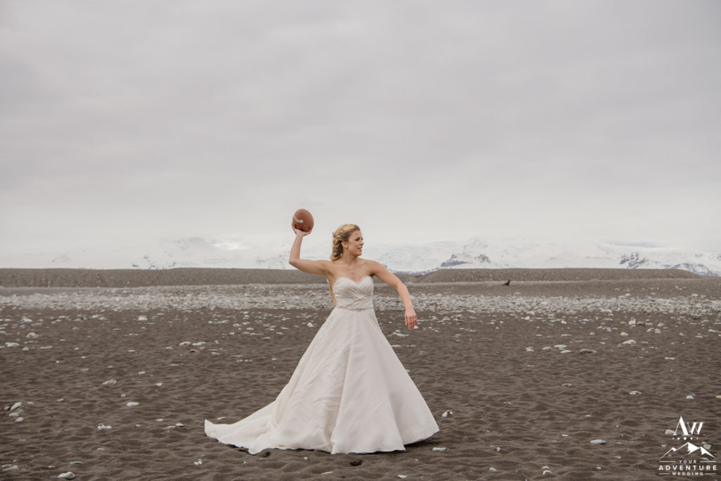 Bride throwing a football on Iceland wedding day
