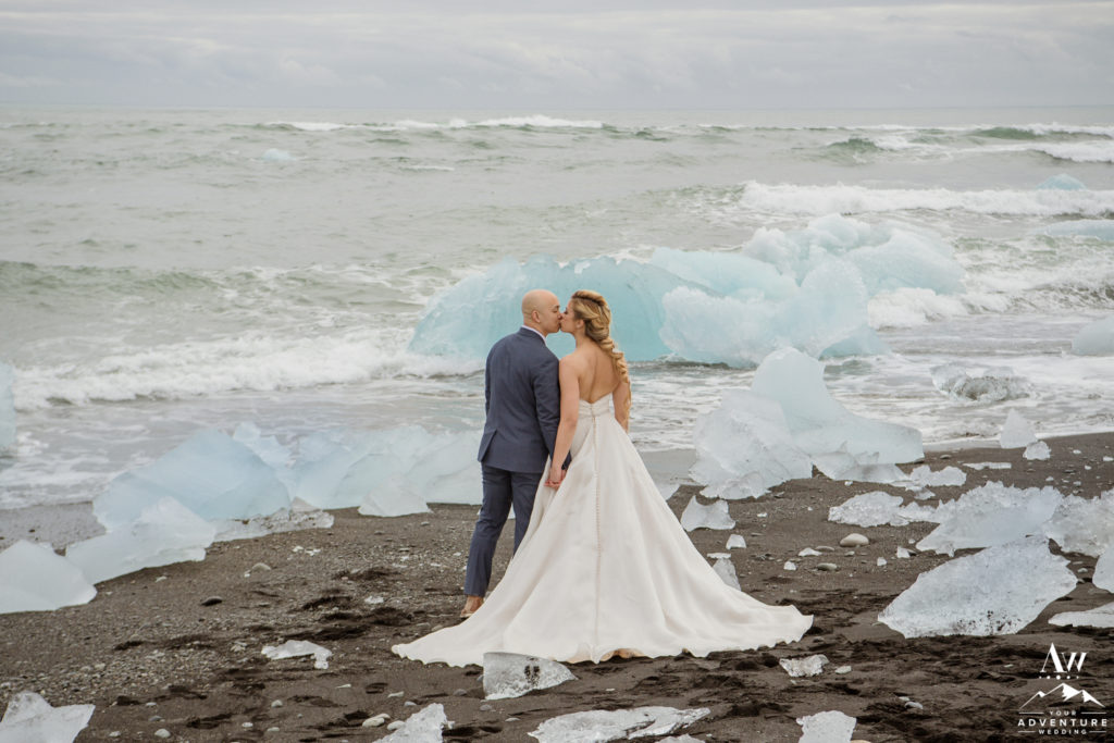 Couple kissing during Iceland wedding on diamond beach