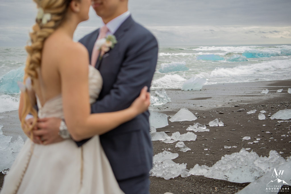 Iceland Wedding Couple hugging at glacier lagoon