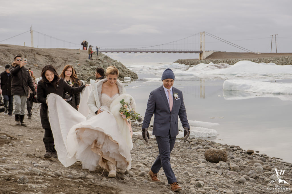 Couple walking to ceremony spot at Jökulsárlón Glacier Lagoon