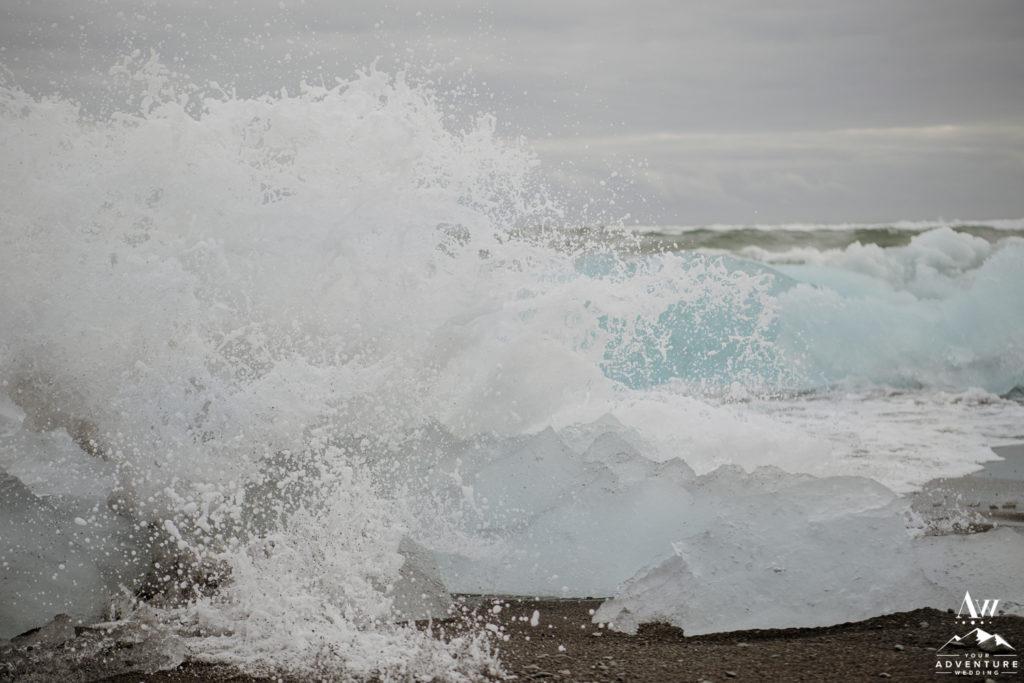 Wave crashing on Diamond Beach in Iceland