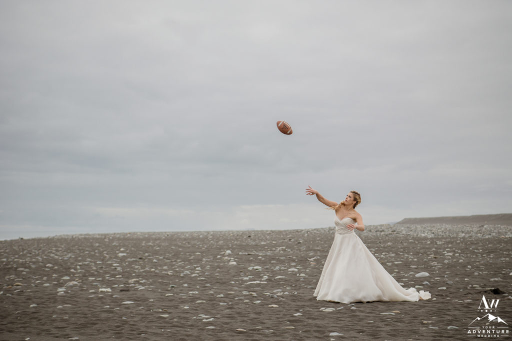 Bride throwing a football on diamond black beach in Iceland