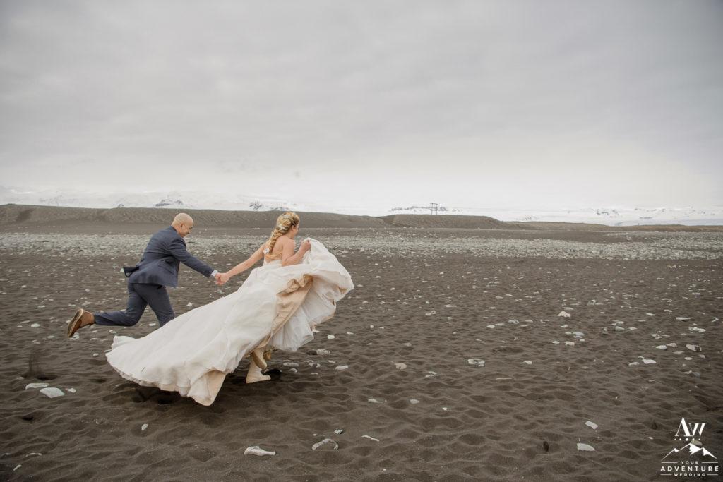 Iceland wedding couple running on Diamond Black Sand Beach