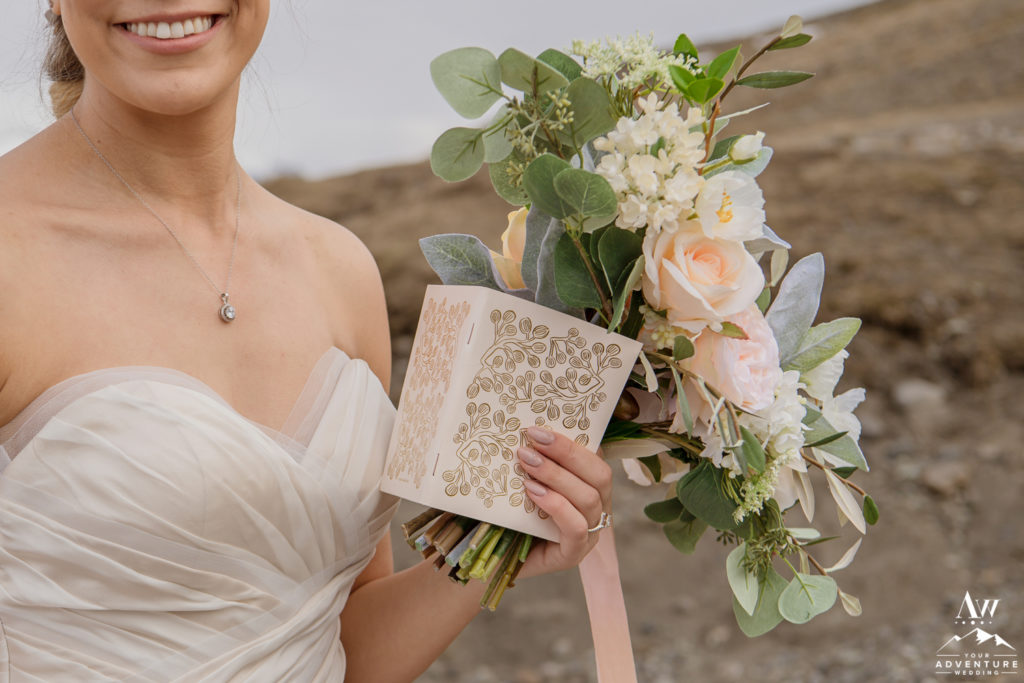 Iceland Wedding Bride holding her bouquet and vow book