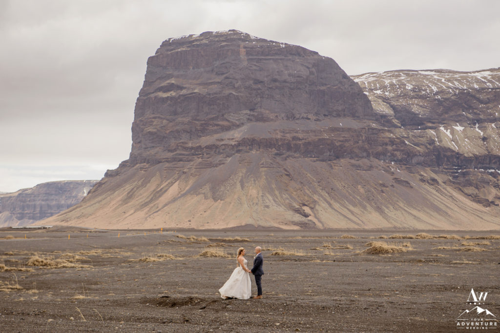 Iceland wedding couple standing in front of Lómagnúpur Mountain
