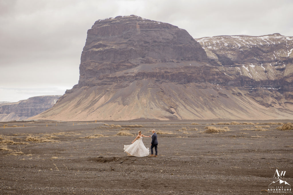 Iceland Wedding Couple dances in front of Lómagnúpur Mountain