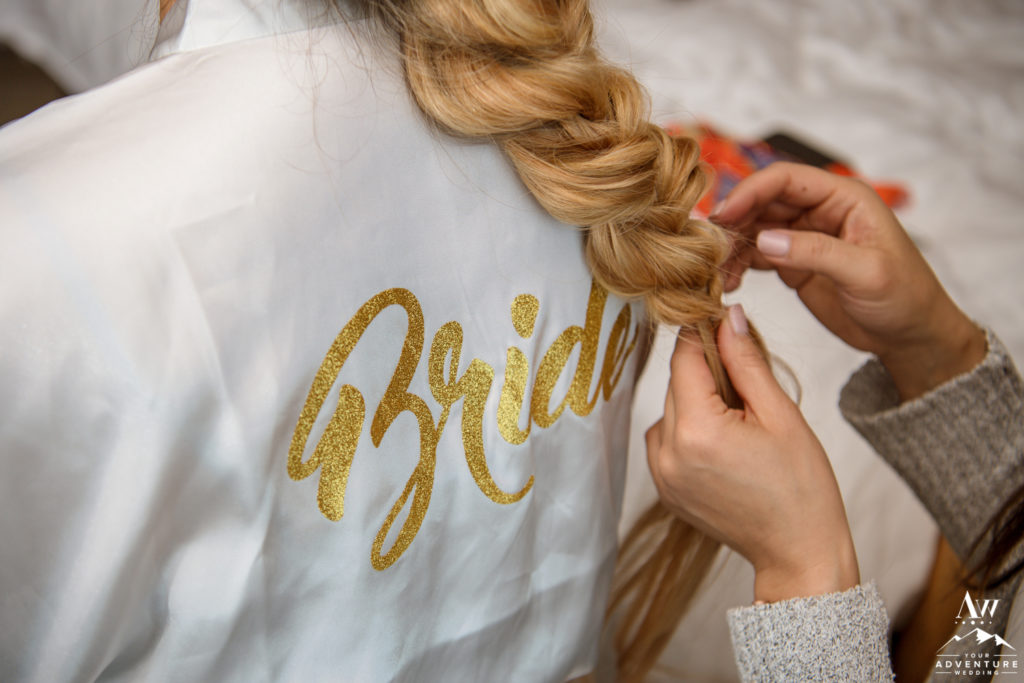 White and Gold Bride Rope during Iceland wedding day