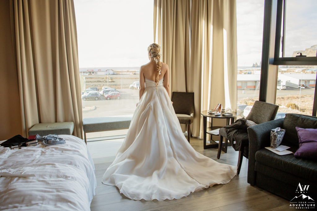 Bride getting her Iceland wedding dress on