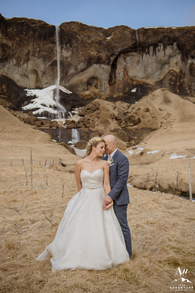 Iceland Wedding Couple Cuddling in front of a waterfall