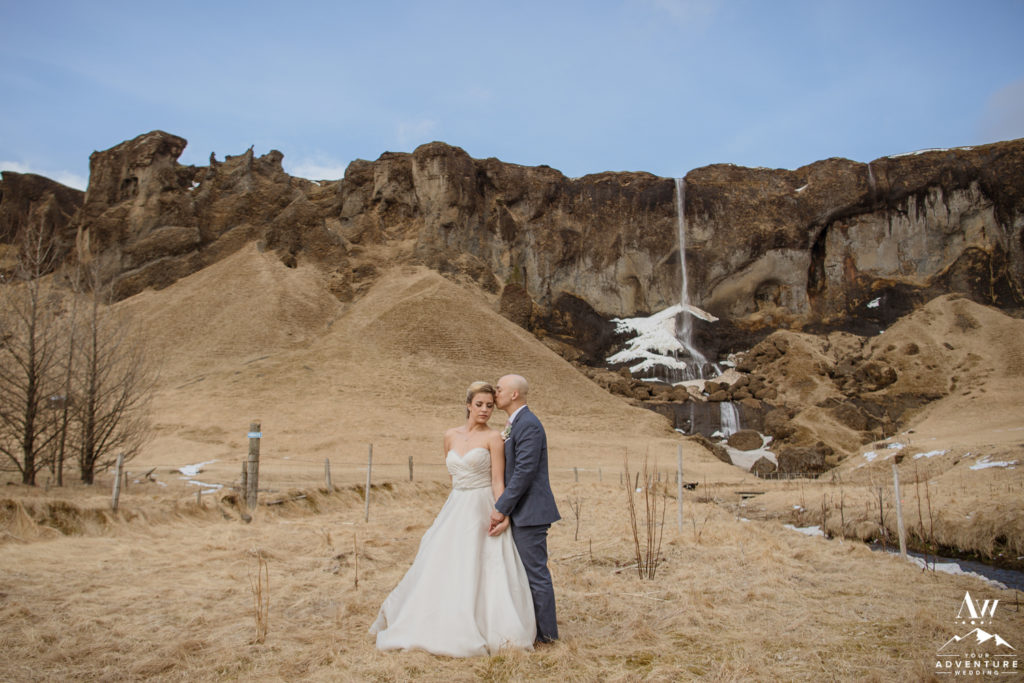Groom Kisses bride at Private Iceland Waterfall