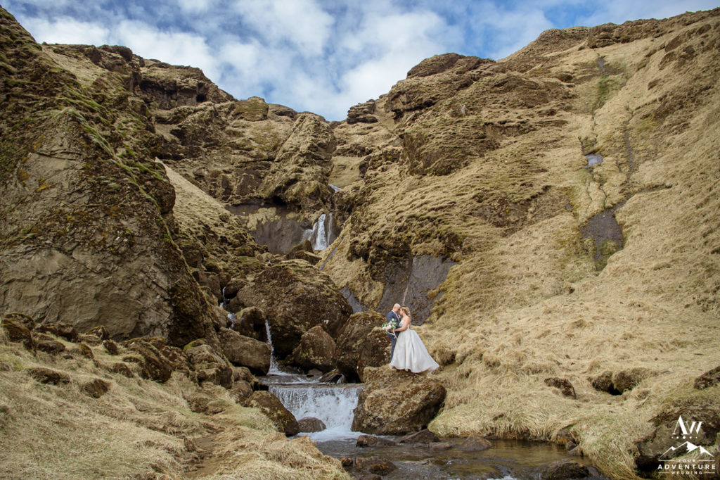 Iceland Wedding Couple standing in front of a hidden waterfall