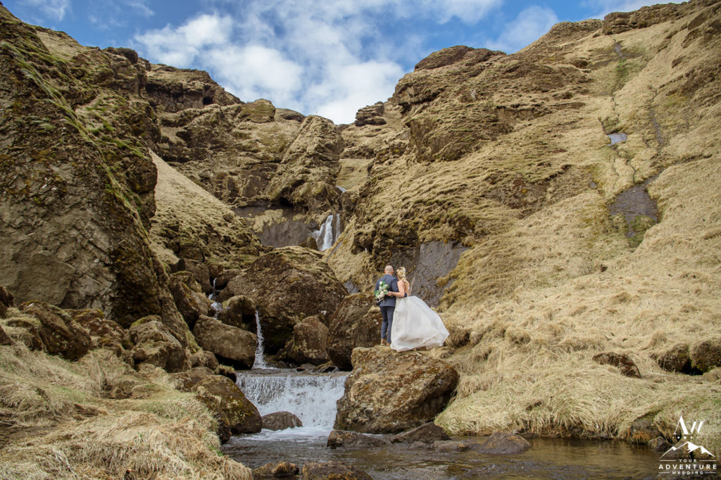 Iceland Wedding Couple facing a secret waterfall