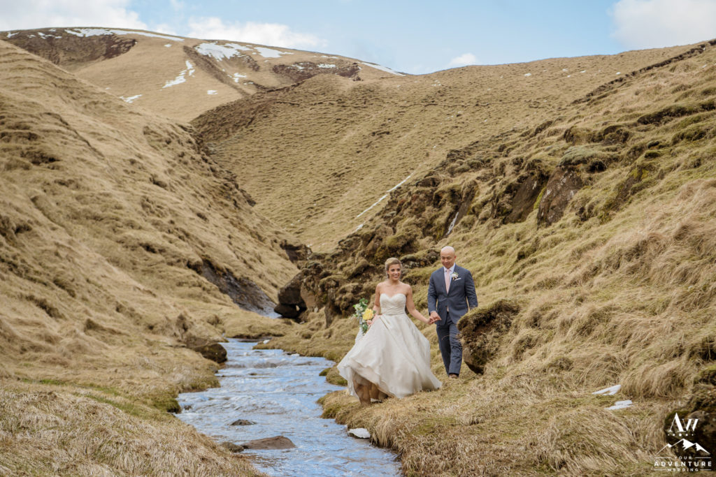 Bride and Groom Walking alongside a river in a canyon