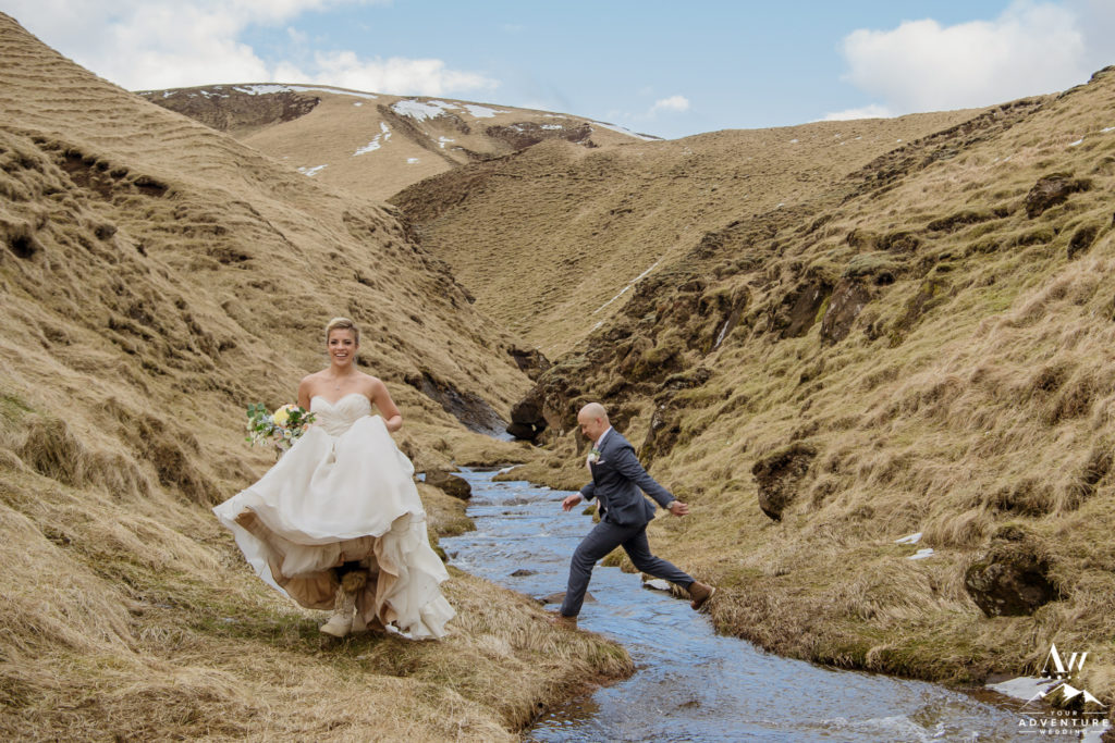 Groom Jumping over River on Iceland Adventure Wedding Day