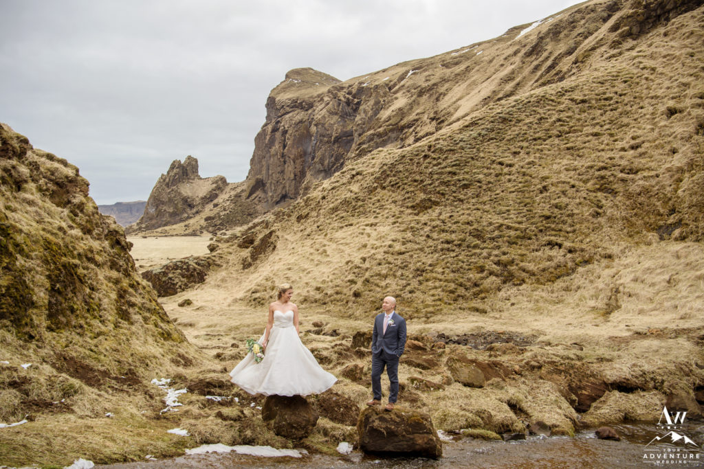 Iceland wedding couple standing on rocks in a canyon