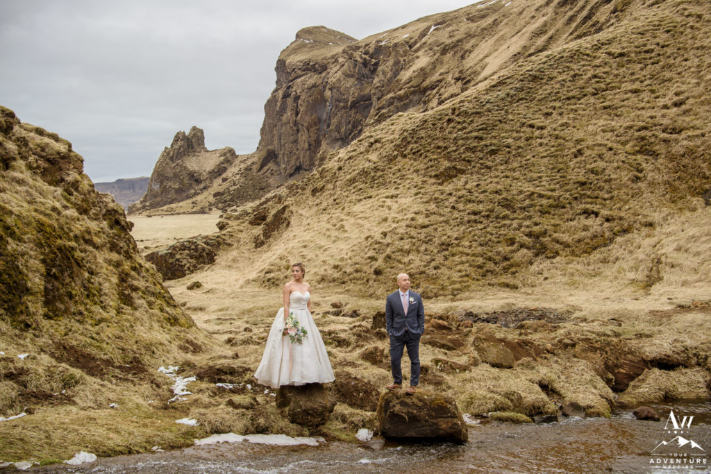 Bride and Groom looking different directions on Iceland Wedding Day