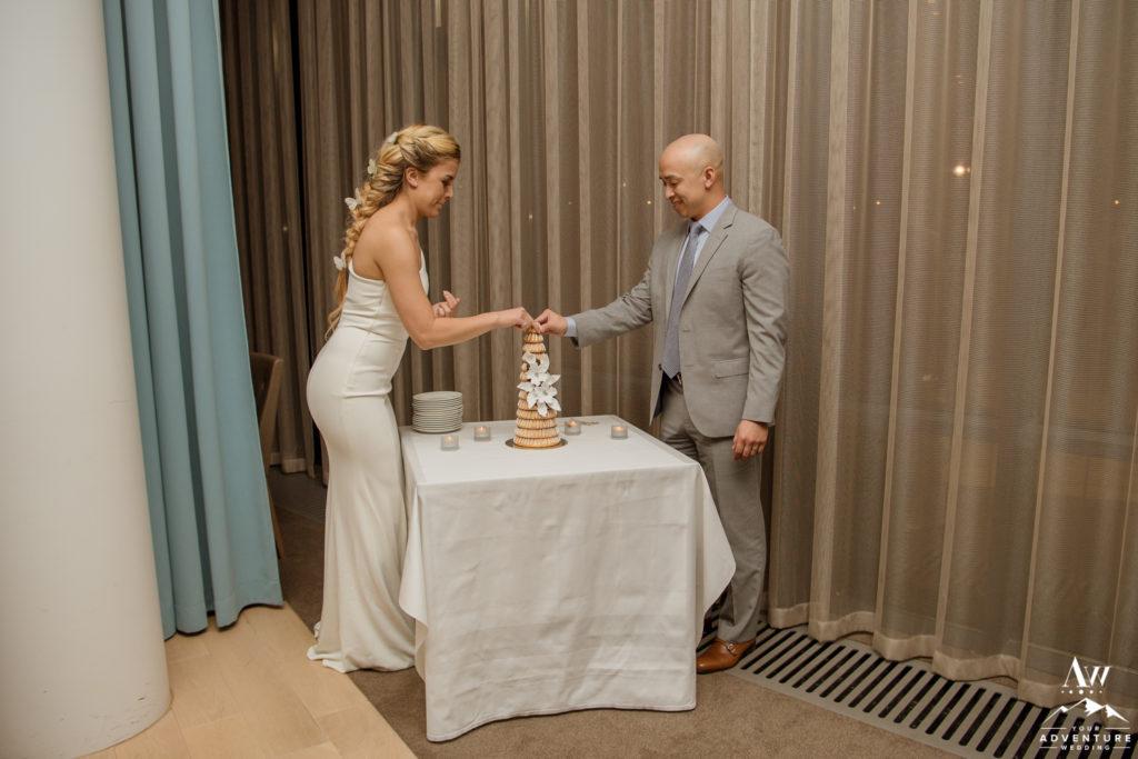Couple with their Kransakaka Iceland Wedding Cake
