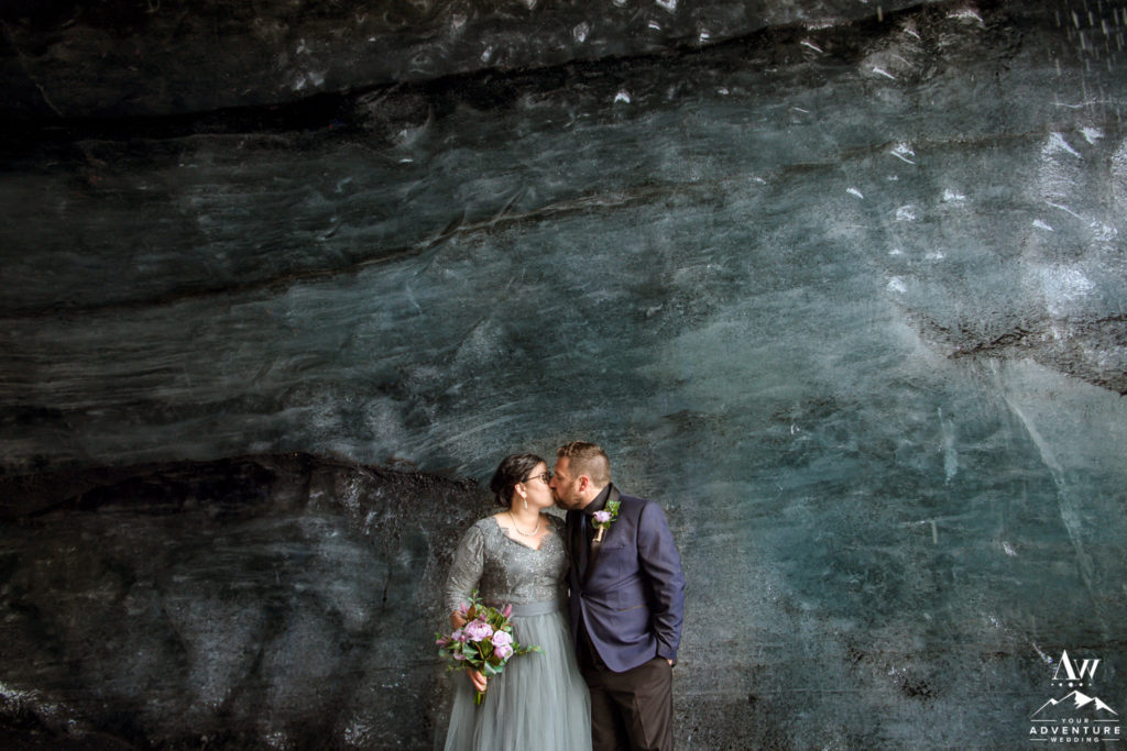 Couple kisses inside of an ice cave during Iceland Elopement
