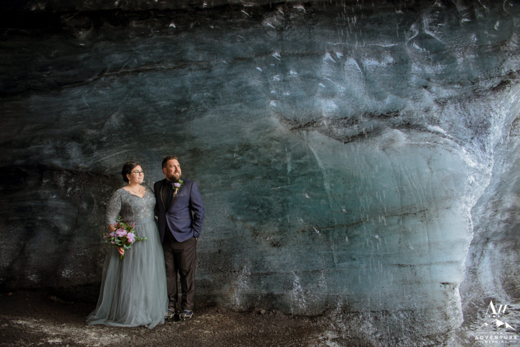 Iceland Elopement couple looking outside of their ice cave