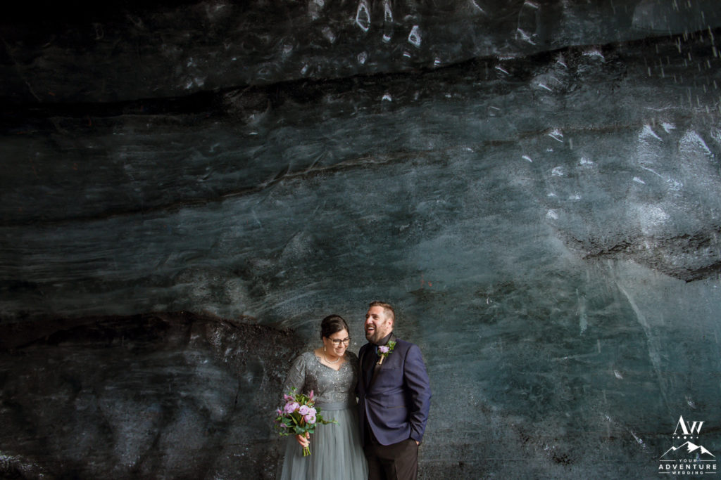 Iceland Wedding Couple laughing in an ice cave