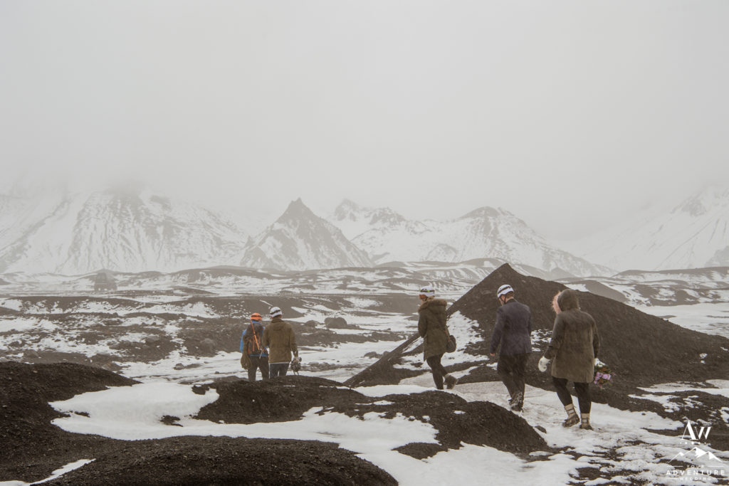 Iceland Wedding Vendors hiking out of a glacier area