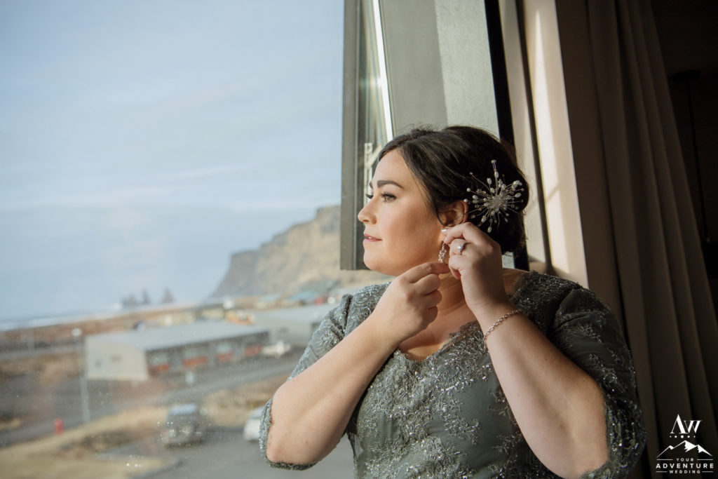 Iceland wedding bride putting on her earrings