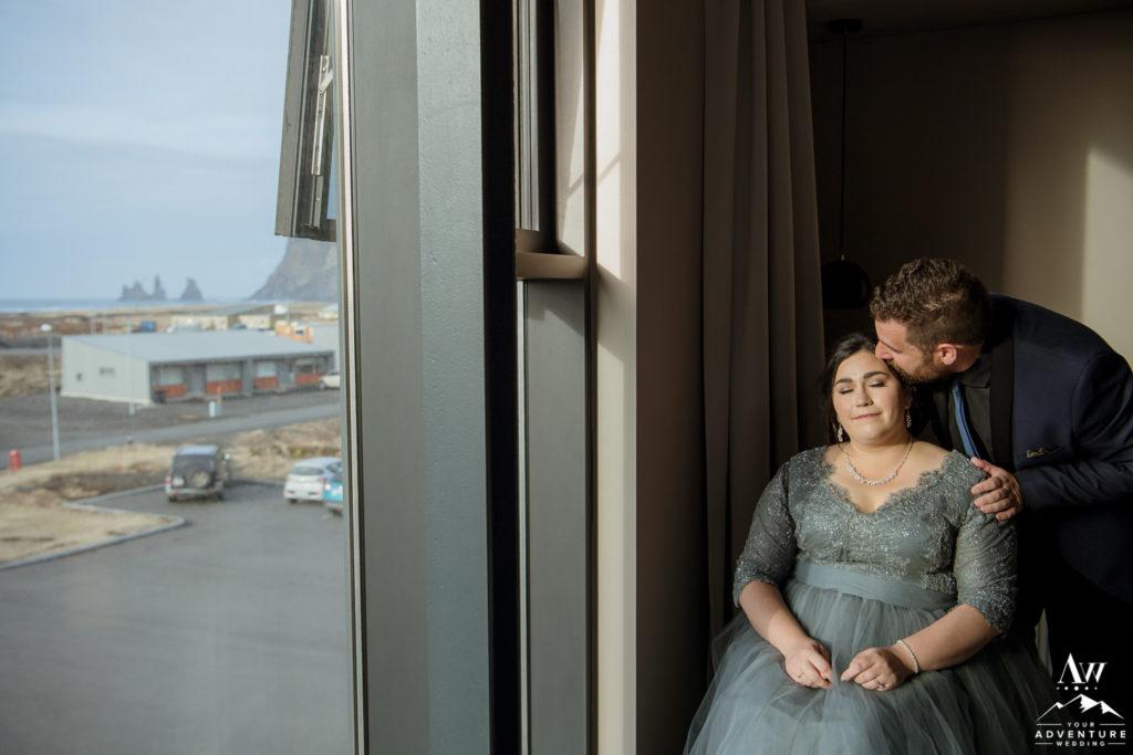 Groom kissing his bride at Icelandair Vik