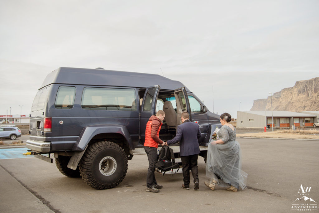 Iceland wedding group loading into super jeep
