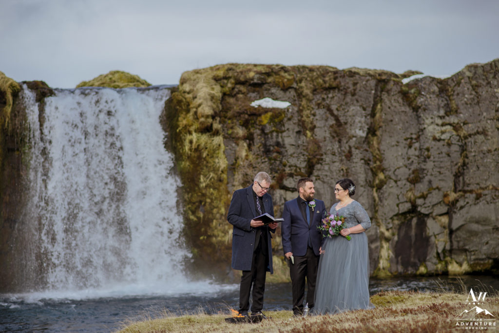 Iceland Elopement Couple during their ceremony at a Waterfall