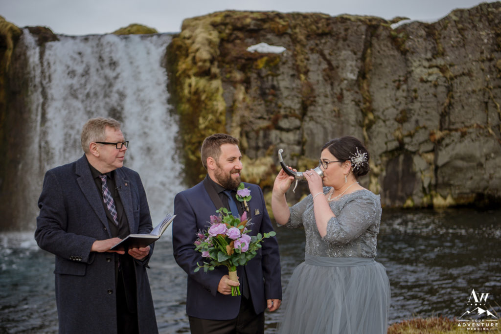 Bride drinking from Norse Horn during Iceland Wedding Ceremony