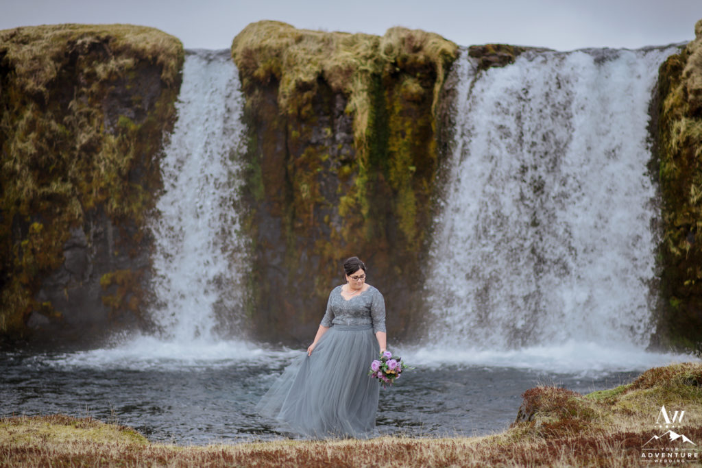 Bride in front of a private waterfall in Iceland