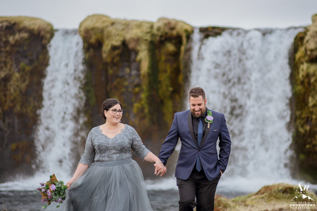 Couple at private waterfall in Iceland