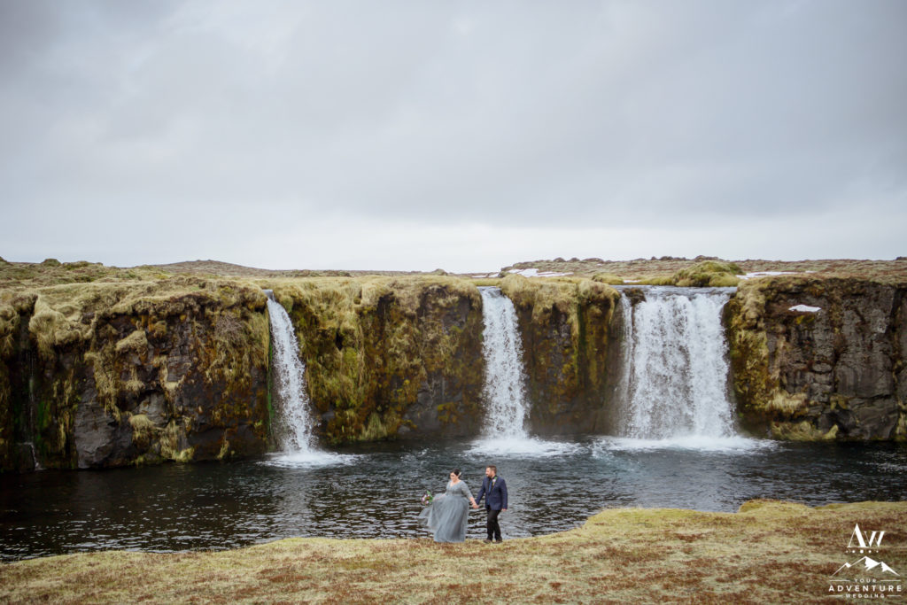 Iceland Wedding Couple exploring a private waterfall