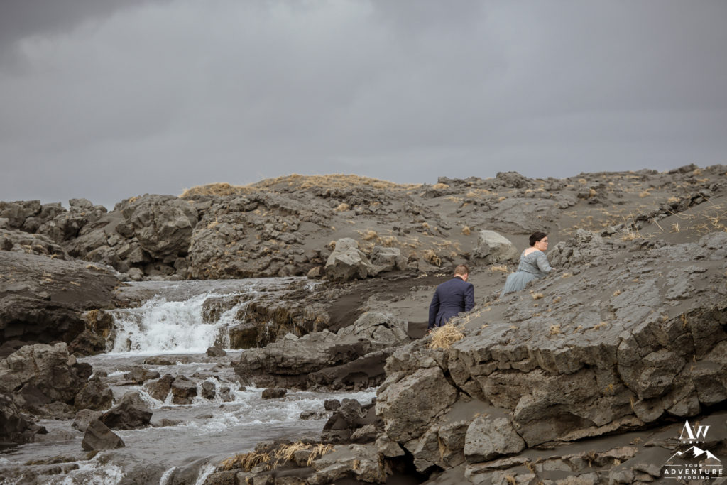 Iceland Wedding Couple Exploring a lava rock waterfall