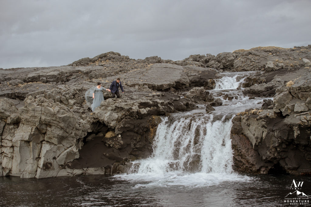 Couple exploring a private waterfall during Icelandic Elopement