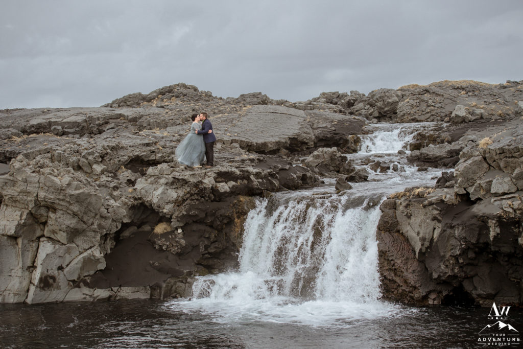 Adventurous Iceland Wedding Couple on top of a private waterfall