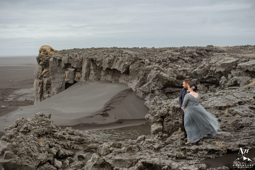 Eloping in Iceland Photos couple standing among lava rocks