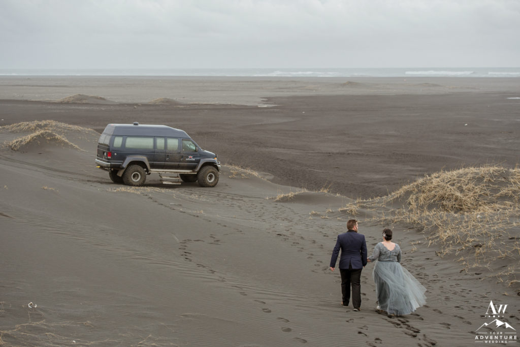 Iceland Wedding Couple walking back to their private super jeep
