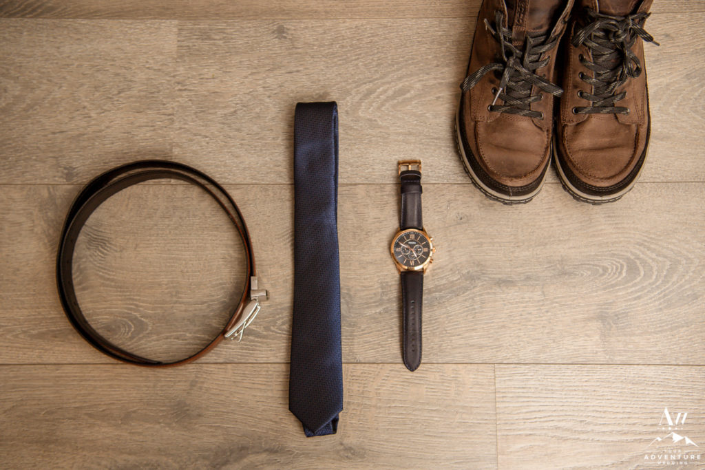 Iceland Elopement Groom Details Belt Watch Tie and Hiking Boots