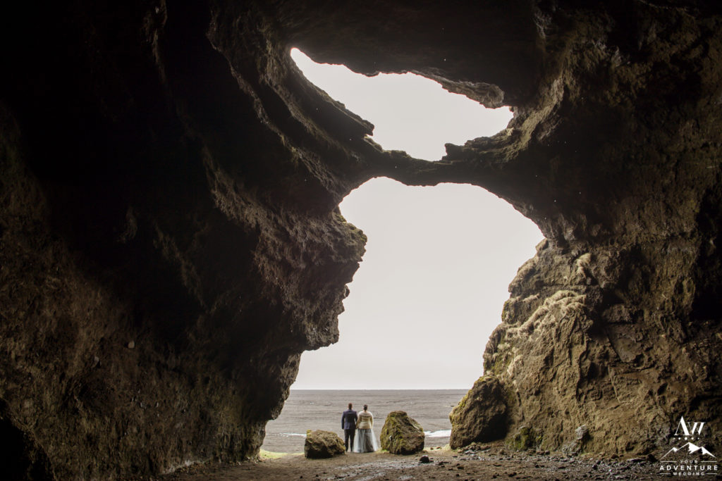 Iceland Wedding Couple Standing at the opening of hjorleifshofdi cave