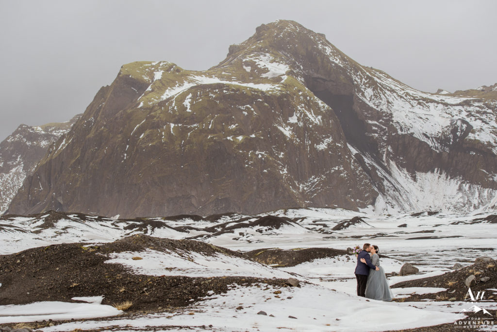 April Iceland Elopement Couple kissing in the snow