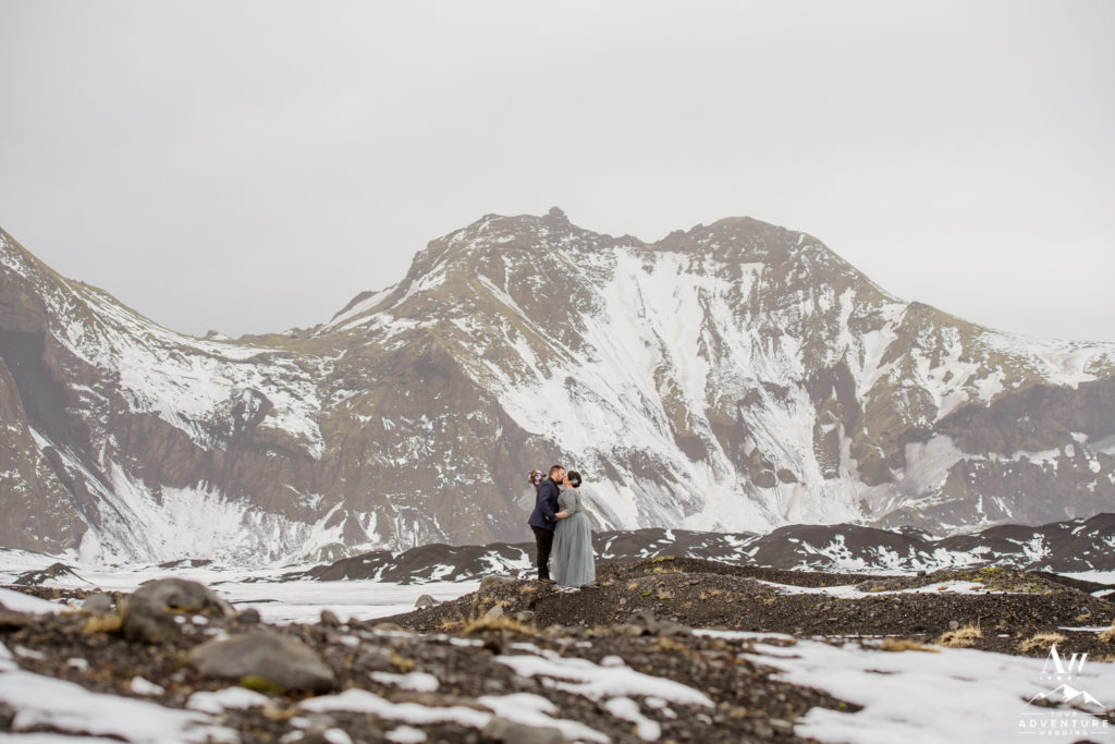 Blue Dress Bride kissing at an Icelandic Glacier Area