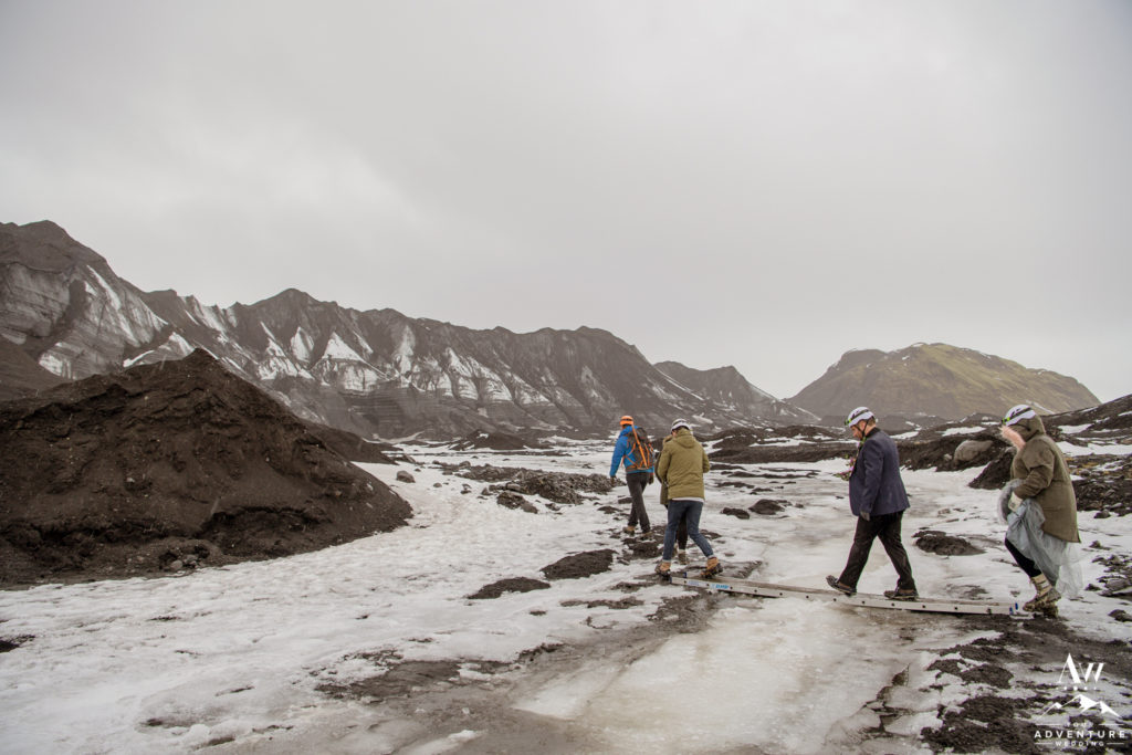 Couple crossing a bridge to a glacier during Iceland Wedding