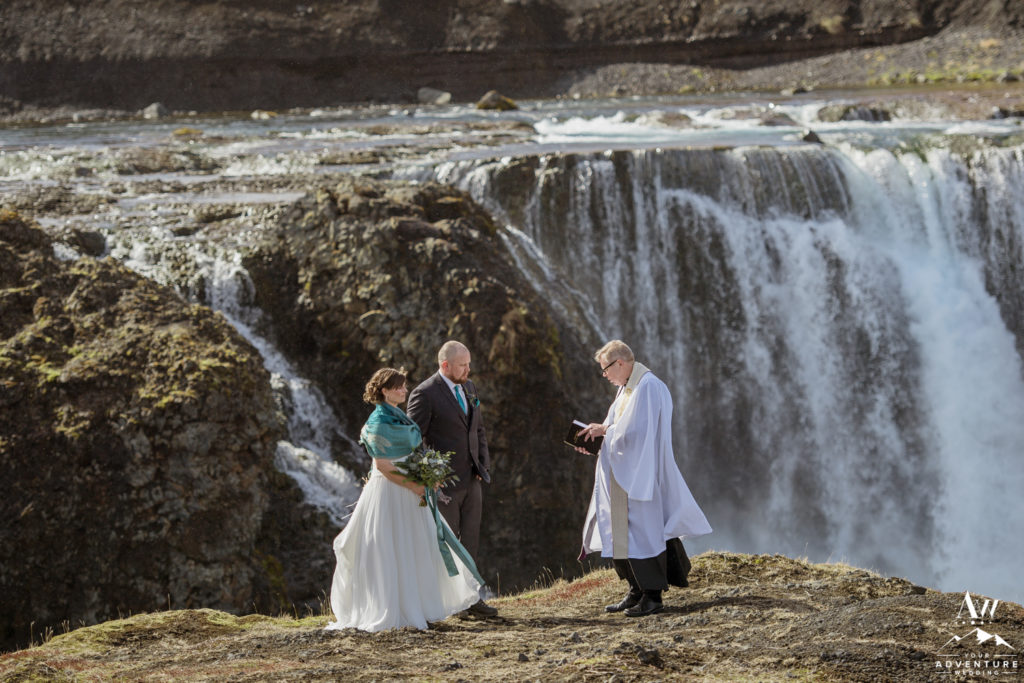 Wedding Ceremony in Iceland in front of a waterfall