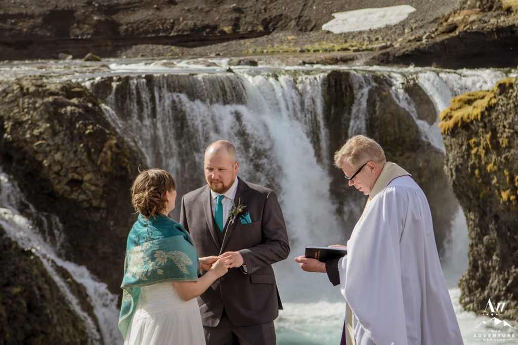 Couple exchanging rings during Iceland elopement ceremony