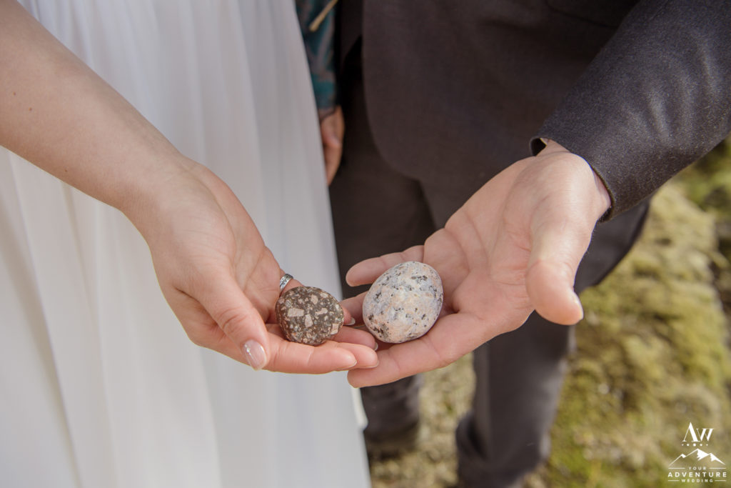 Iceland elopement couple holding rocks they