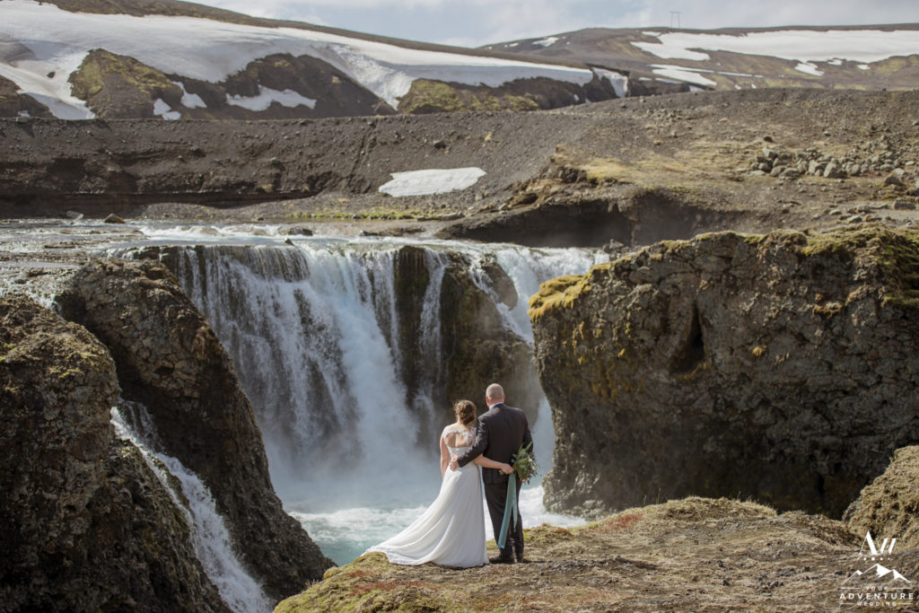 Iceland Elopement Couple Enjoying the Waterfall View