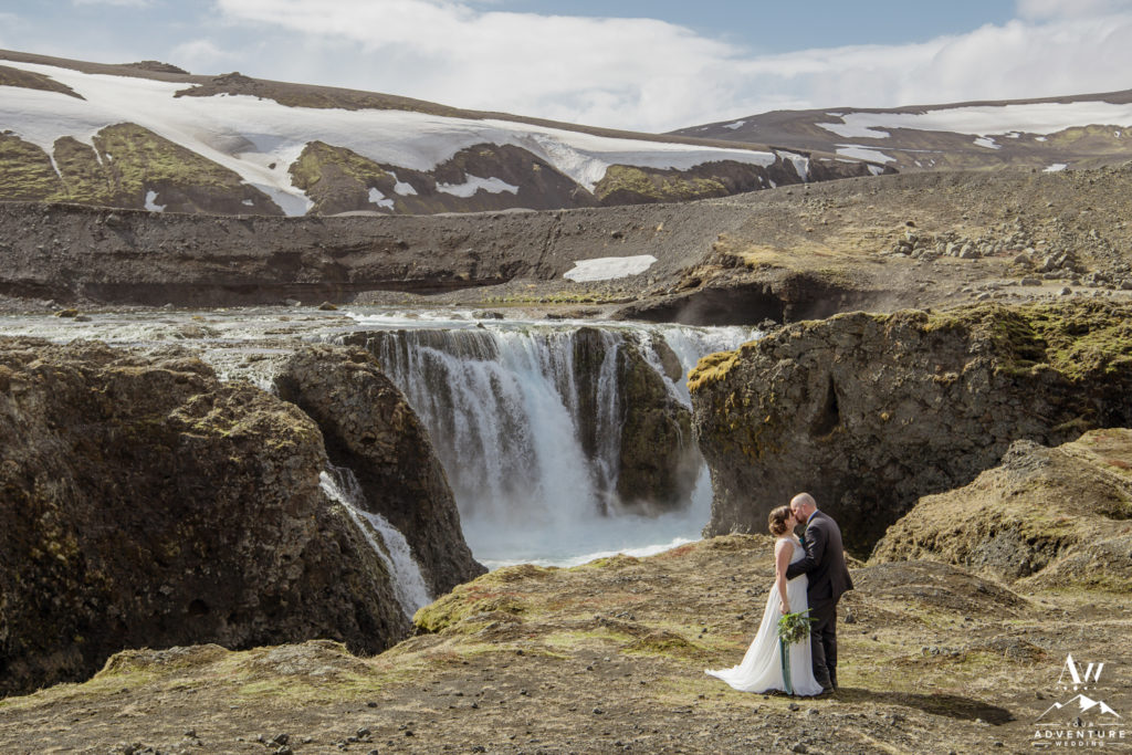 Iceland Wedding Couple Kissing in front of a highland waterfall